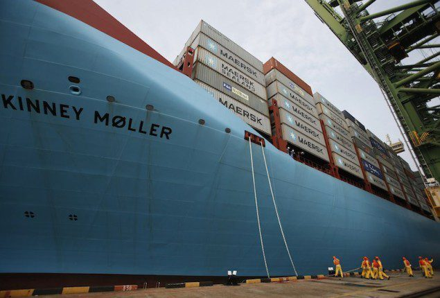 Dock workers tie mooring ropes as the world's largest container ship, the MV Maersk Mc-Kinney Moller. REUTERS/Edgar Su