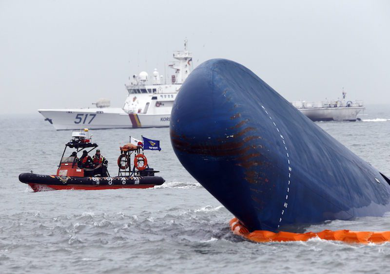 "Rescue boats sail around the South Korean passenger ship ""Sewol"" which sank, during their rescue operation in the sea off Jindo, in this April 17, 2014. REUTERS/Kim Kyung-Hoon"