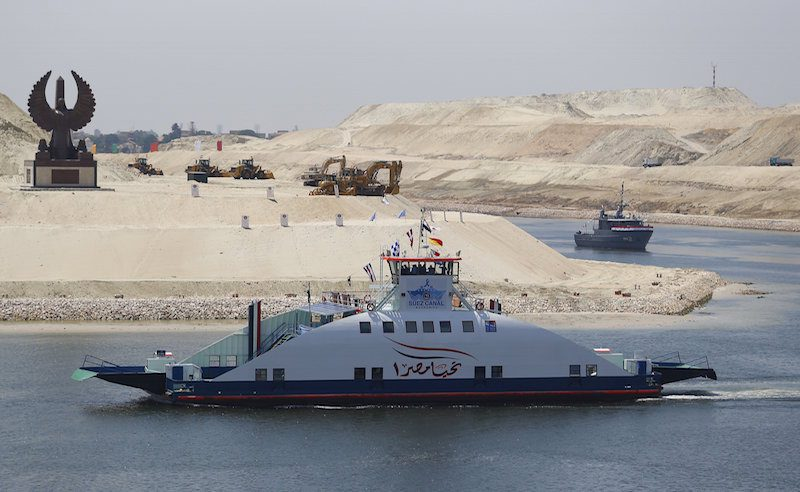 "A ship named ""Long life Egypt"" crosses the new section of the Suez Canal after the opening ceremony of the new Suez Canal, in Ismailia"