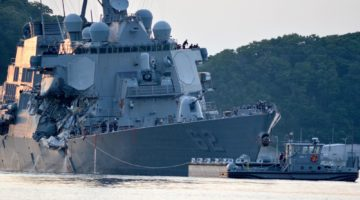 Search Continues As Damaged Destroyer Hobbles Into Port