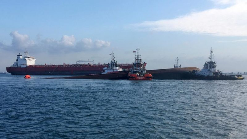 singapore tanker collides with dredger